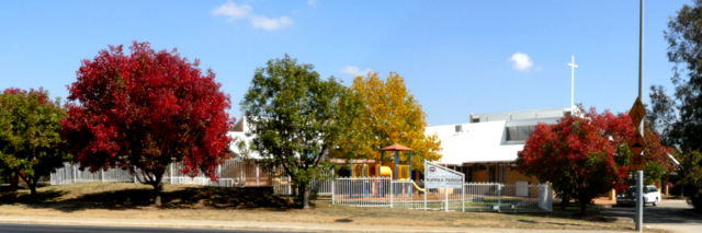 KUC building with autumn trees